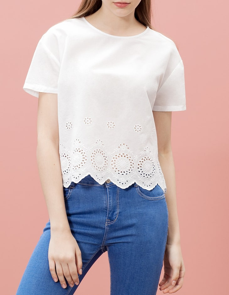 Top with embroidered hem detail