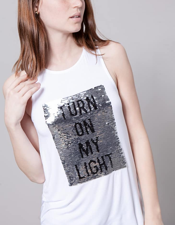 Reversible sequinned text top