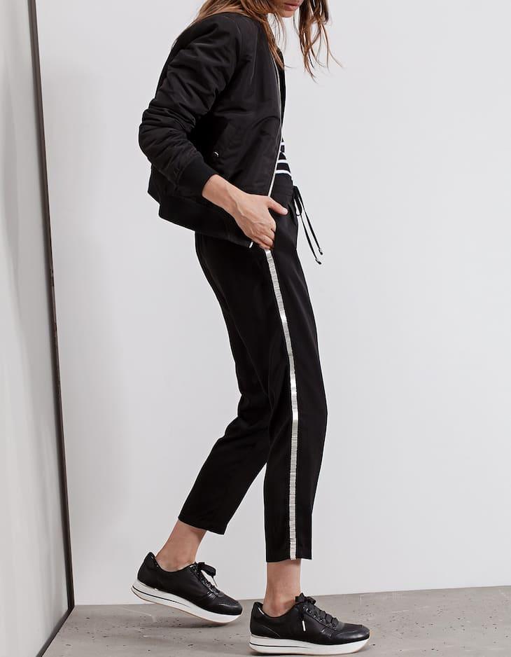 Loose fitting trousers with jewel trim