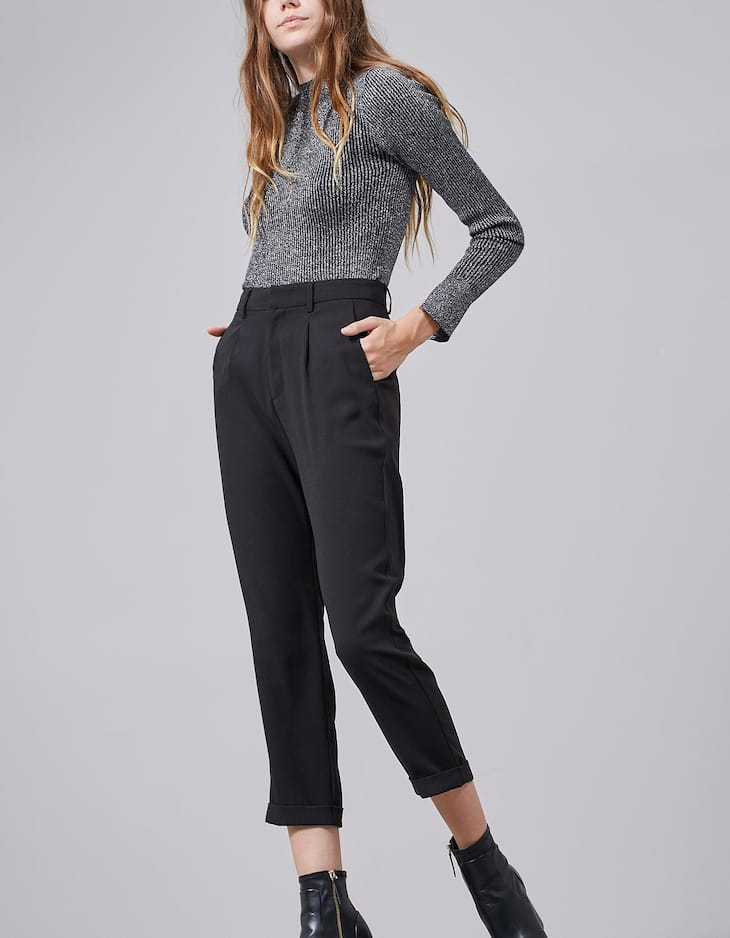 Trousers with pleat detail