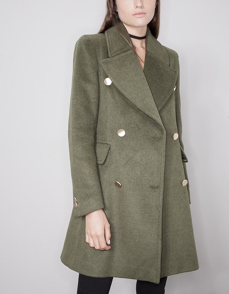 Lady coat with gold buttons