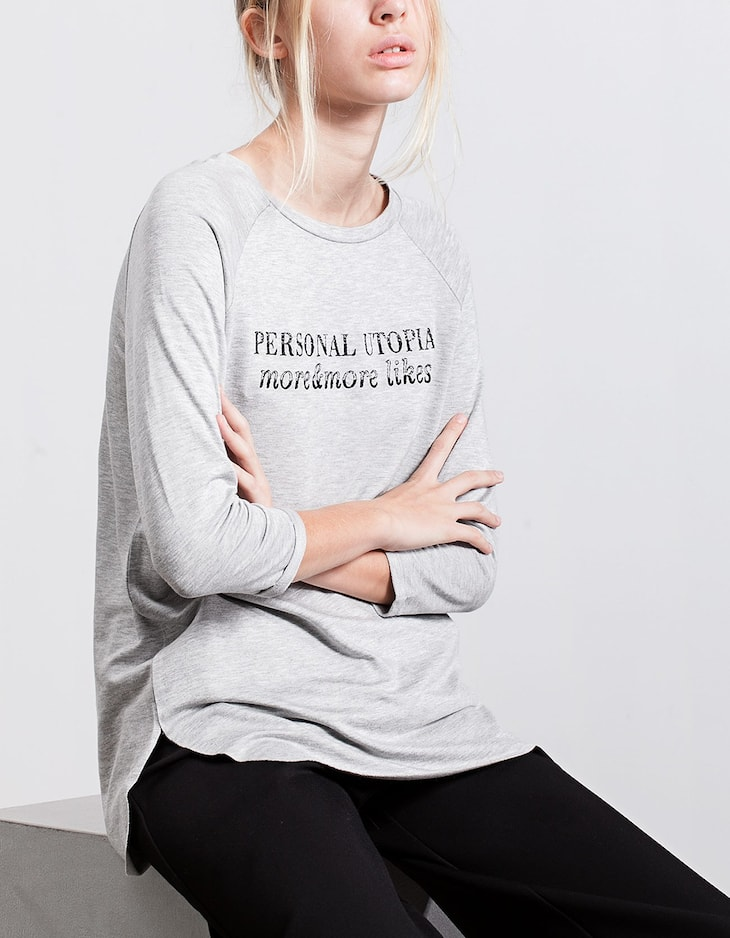 Top with embroidered text detail