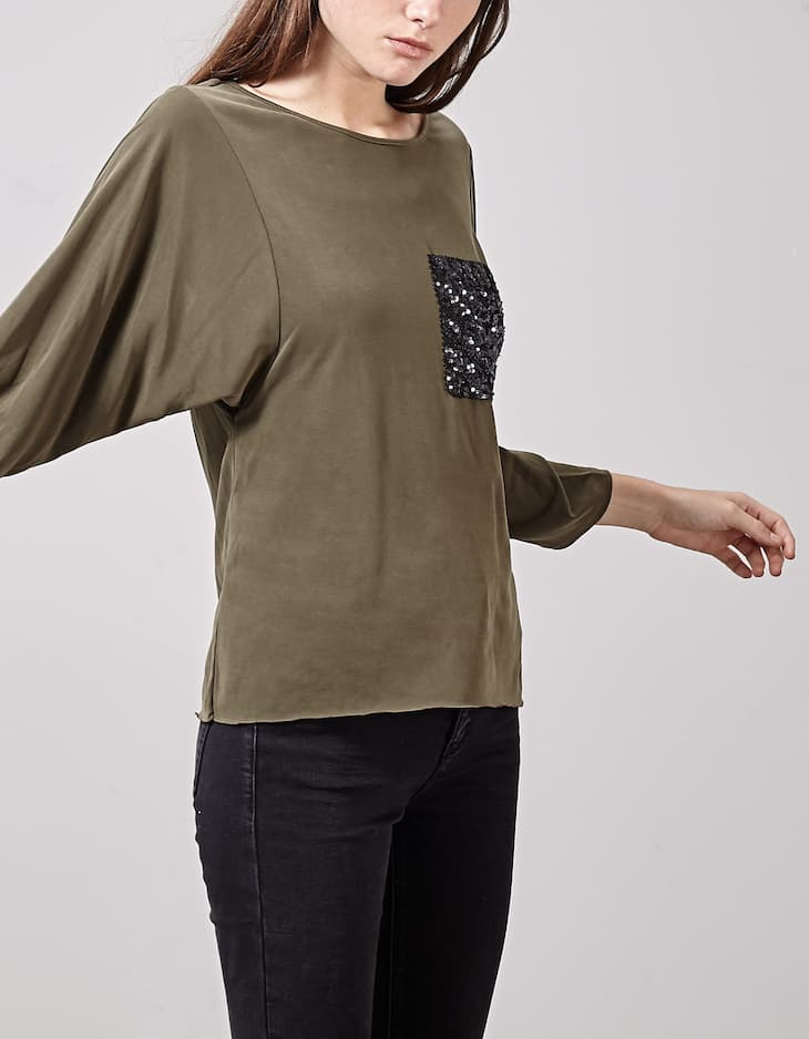 Top with sequinned pocket detail