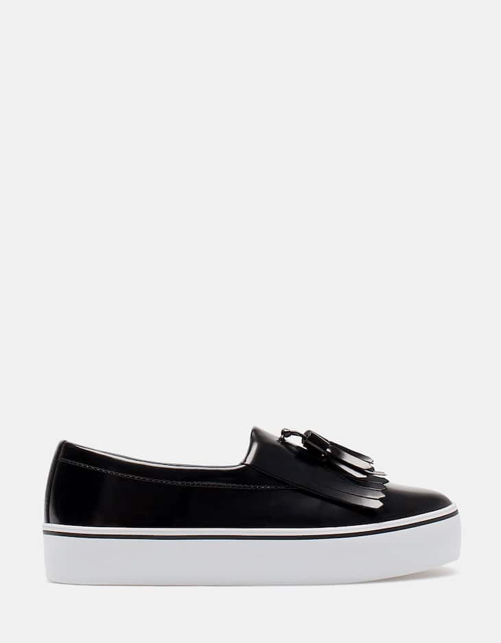 Slip ons with tassel detail