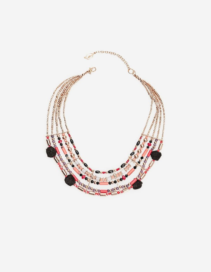 Beaded multi-strand necklace with pompoms