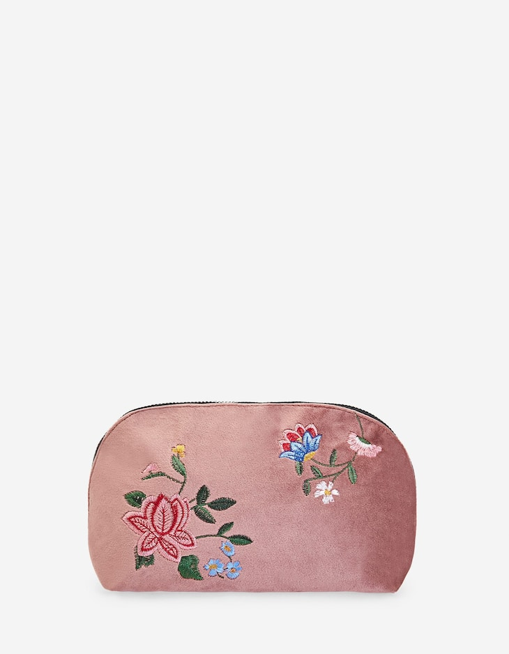 Toiletry bag with floral embroidery