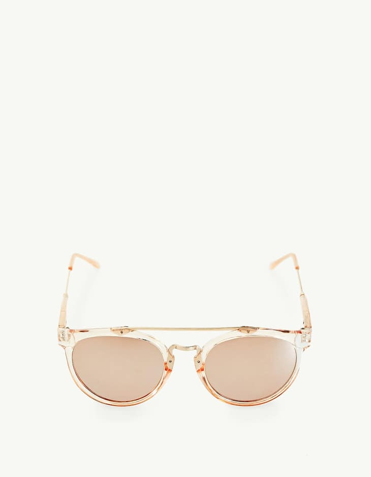 Pink sunglasses with a metal bridge