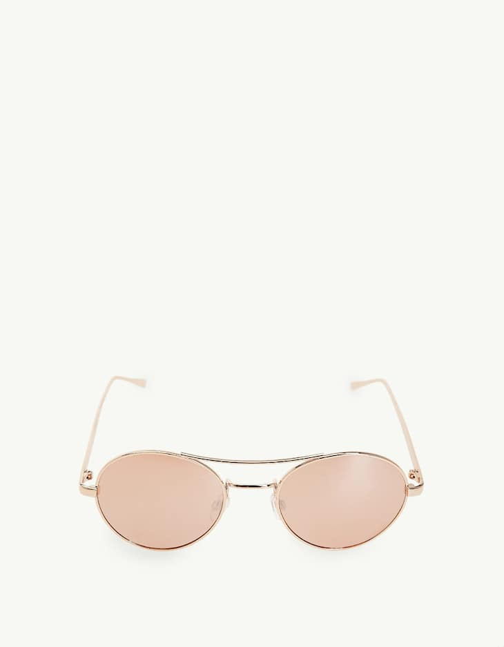 Round metal sunglasses with pink lenses