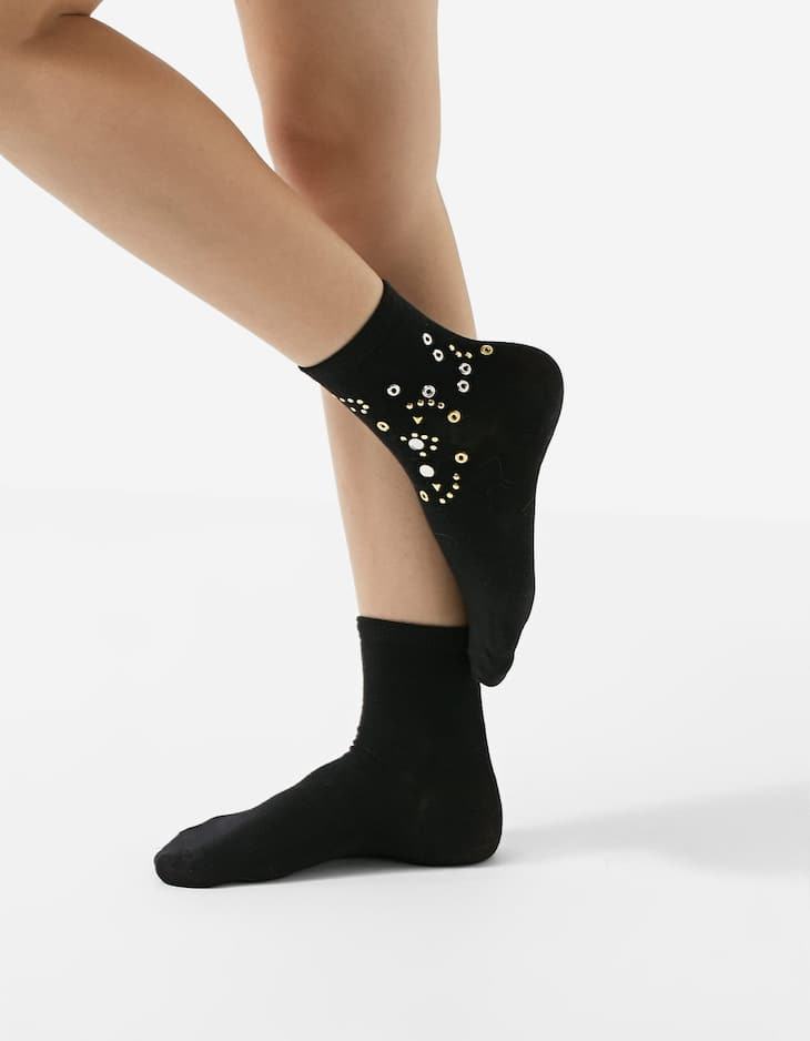 Socks embellished with eyelets and studs