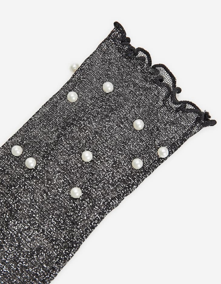 Socks adorned with pearl beads