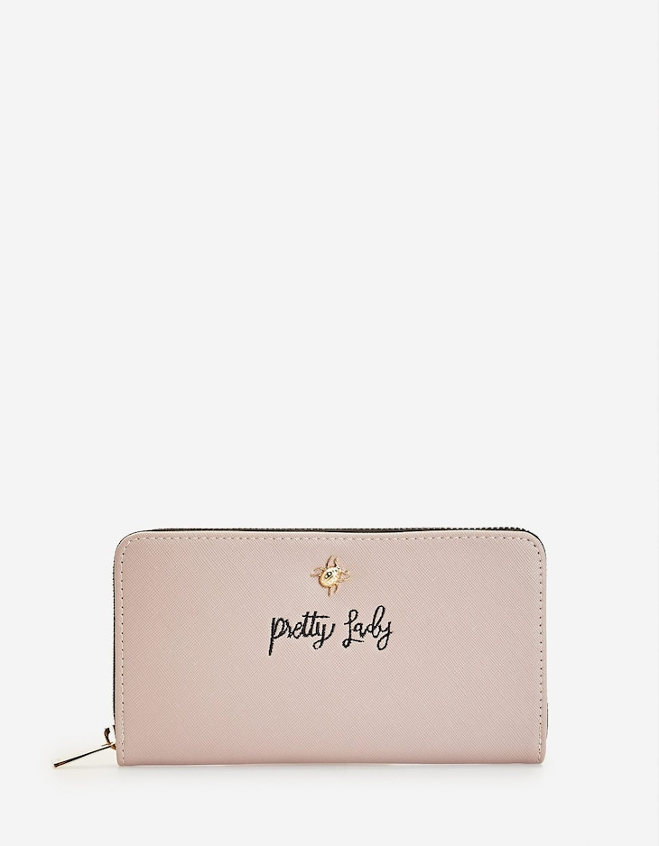 Embossed purse with slogan