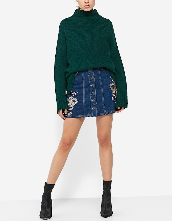 Buttoned embroidered denim skirt with buttons