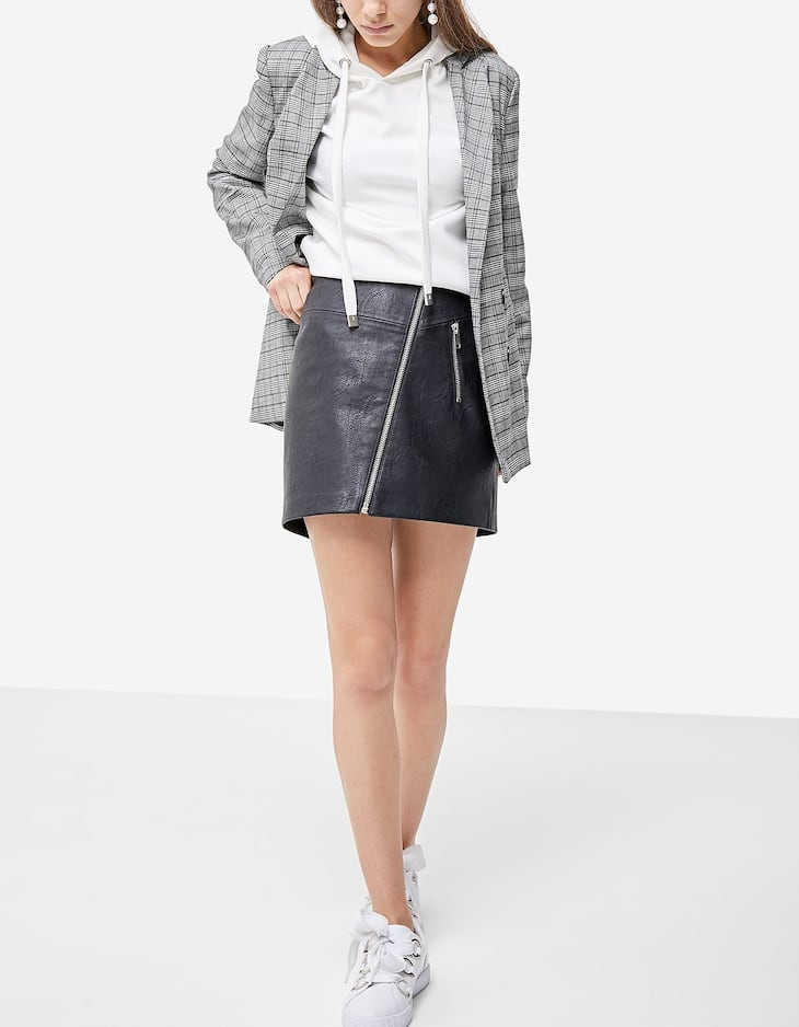 Faux leather skirt with diagonal zip