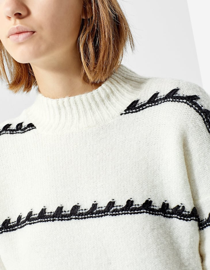 Sweater with stitching details