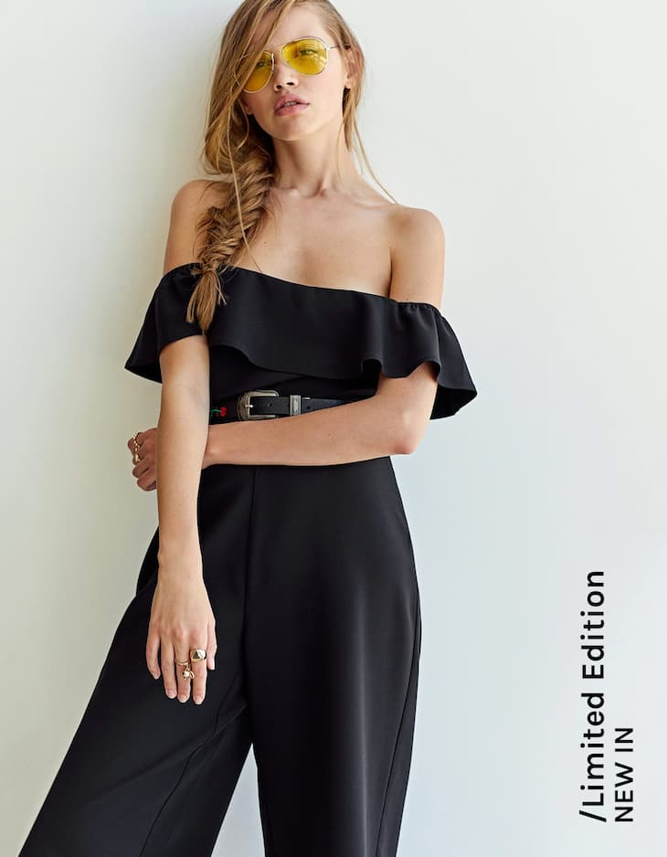 Ruffled jumpsuit with exposed shoulders