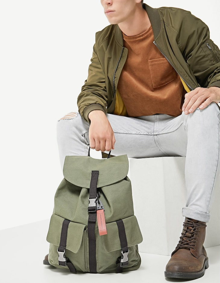 Canvas backpack with clips