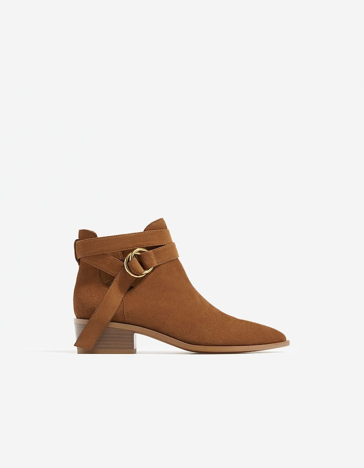 Buckled LEATHER ankle boots with cut-out sides