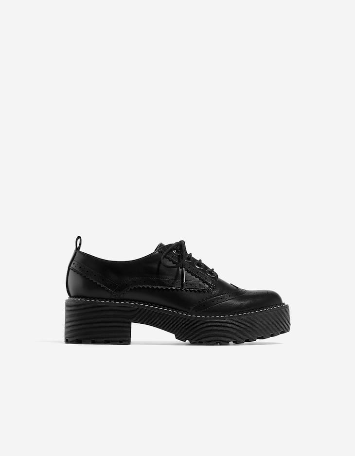 Black brogues with track soles