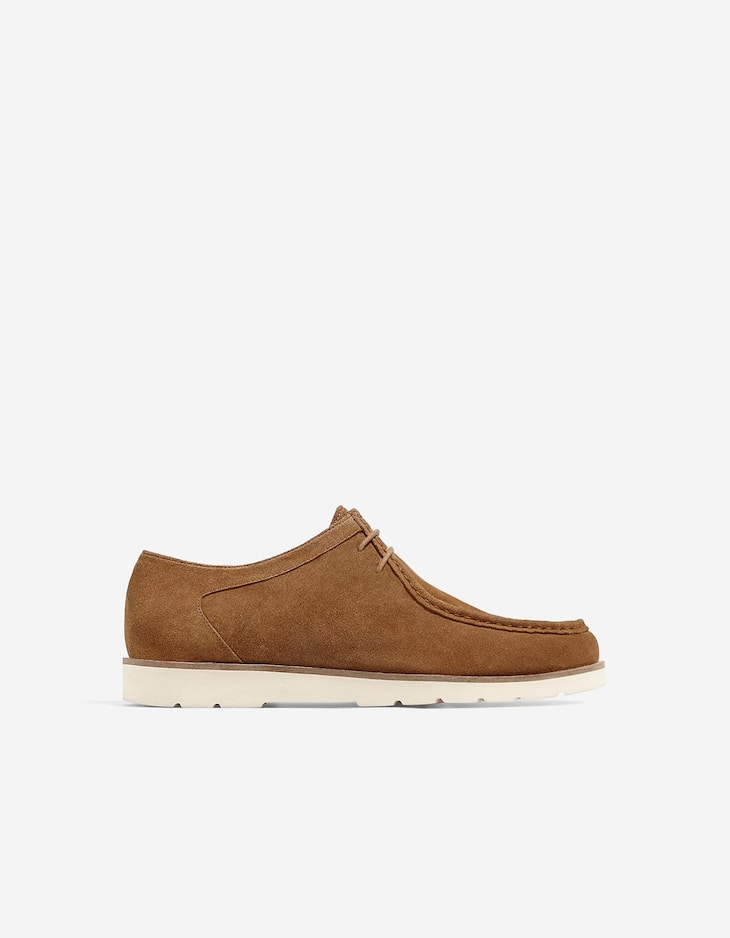 Brown leather wallabee shoes
