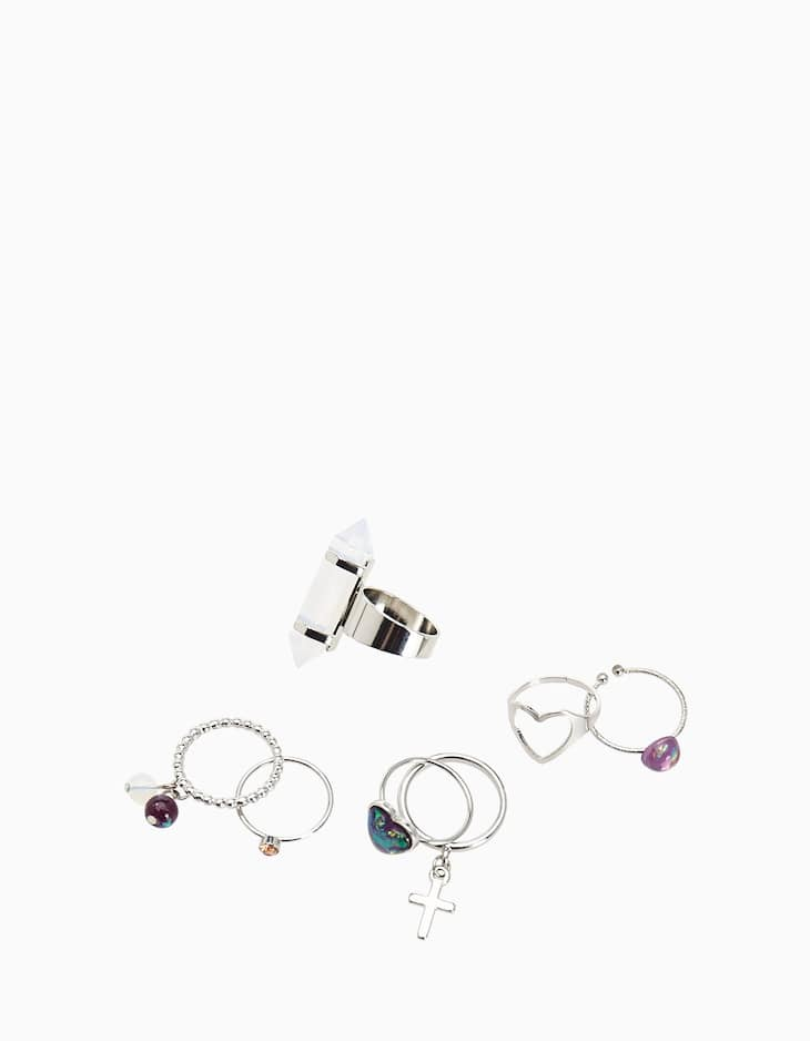 8 iridescent jewelled rings with cross detail