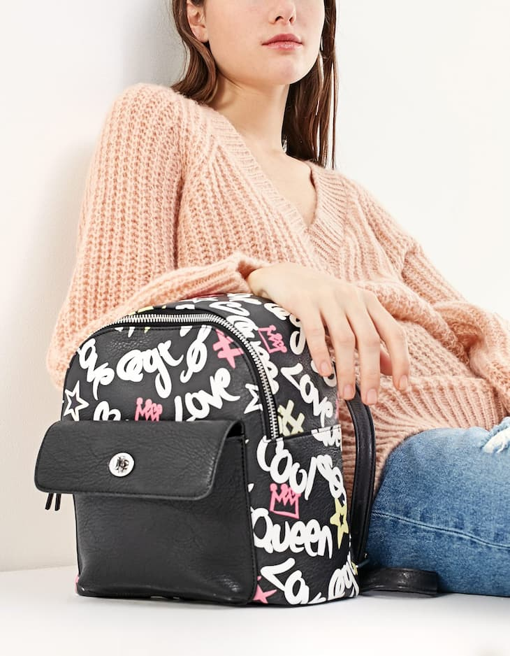 Print backpack with pocket detail
