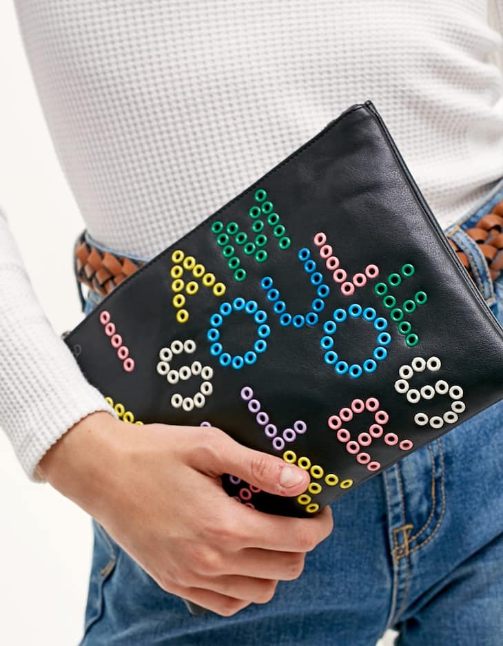 Pochette with eyelet trim and message