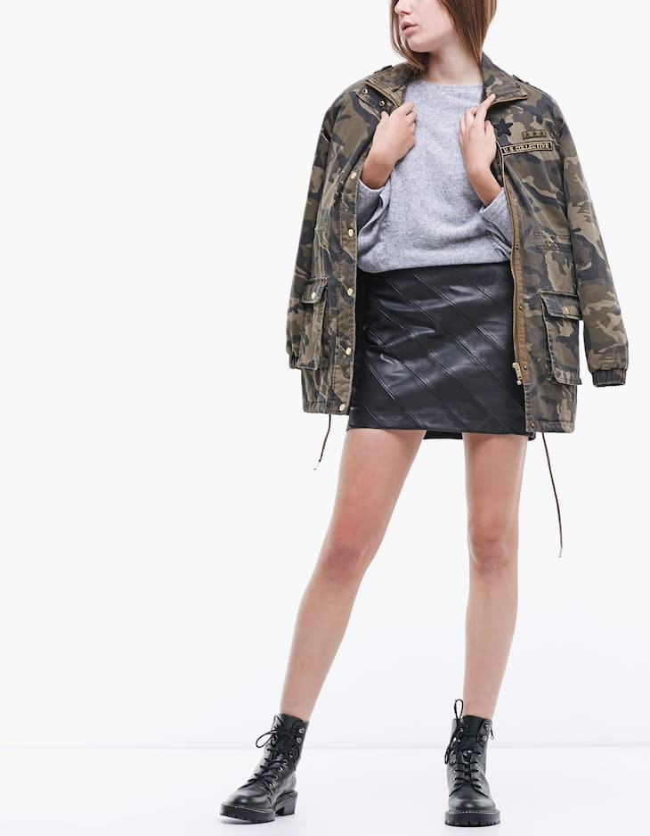 Diagonal fit leather look skirt