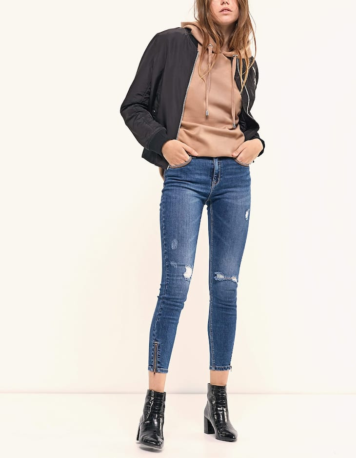 High waist jeans with leather-effect details