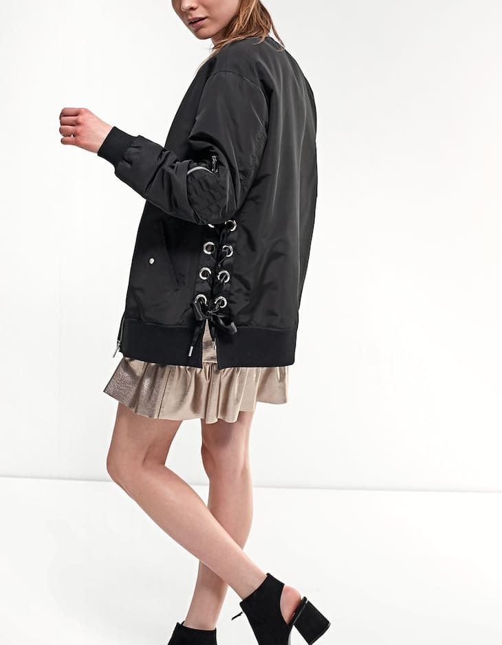 Bomber jacket with side eyelet trim