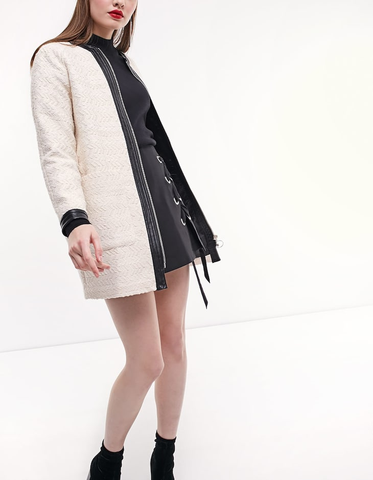 Jacquard coat with leather look trims