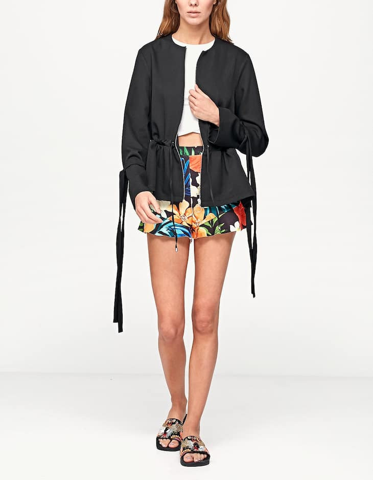 Jacket with bows on sleeves