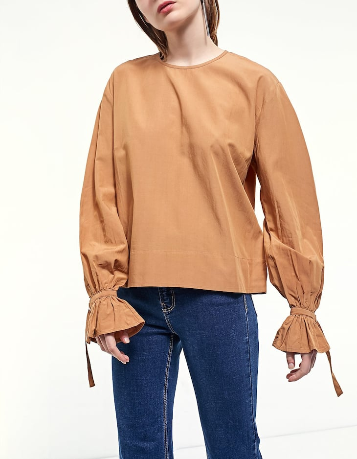 Flared sleeve shirt with buckle trim