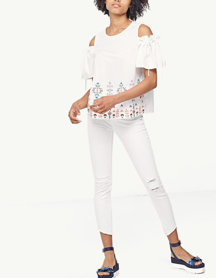 Embroidered top with cut-out shoulders