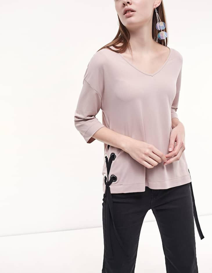 Top with side eyelet detail