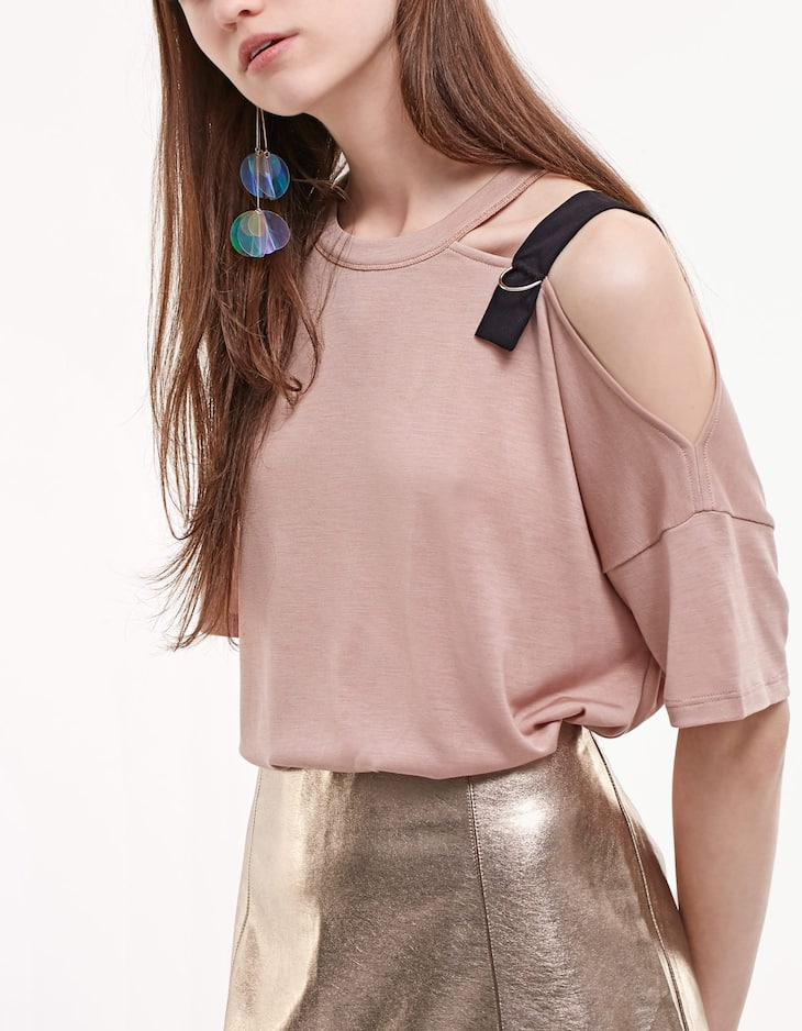 Top with shoulder buckle trim