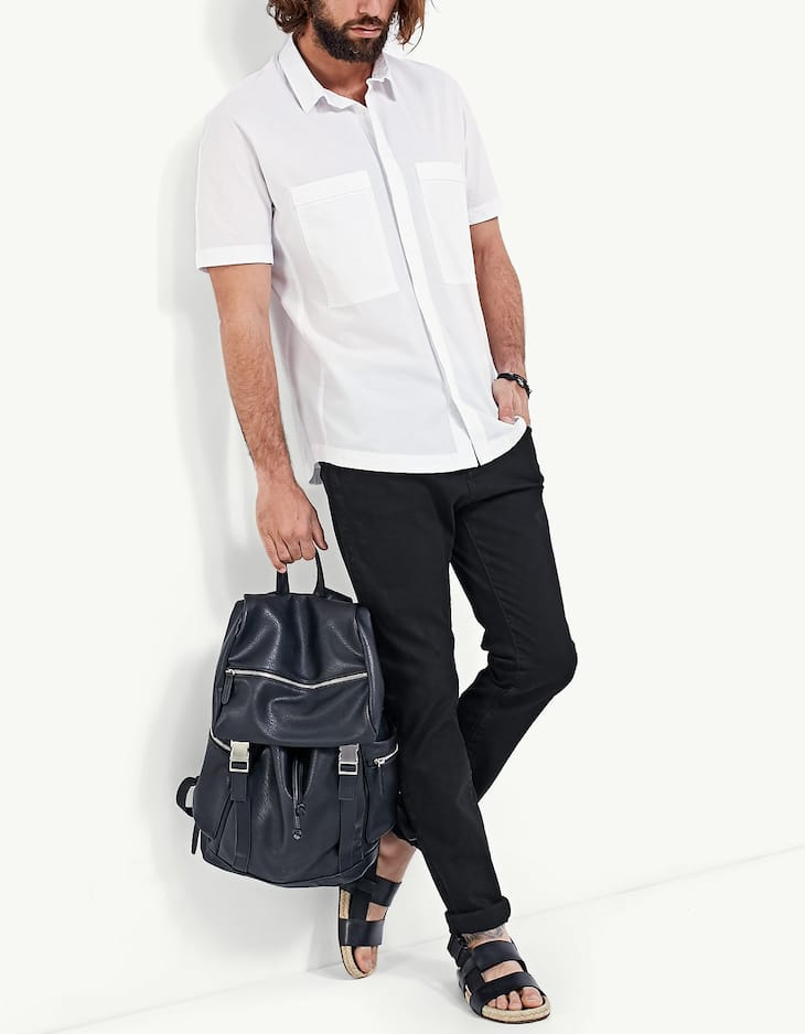 White shirt with short sleeves and large pockets