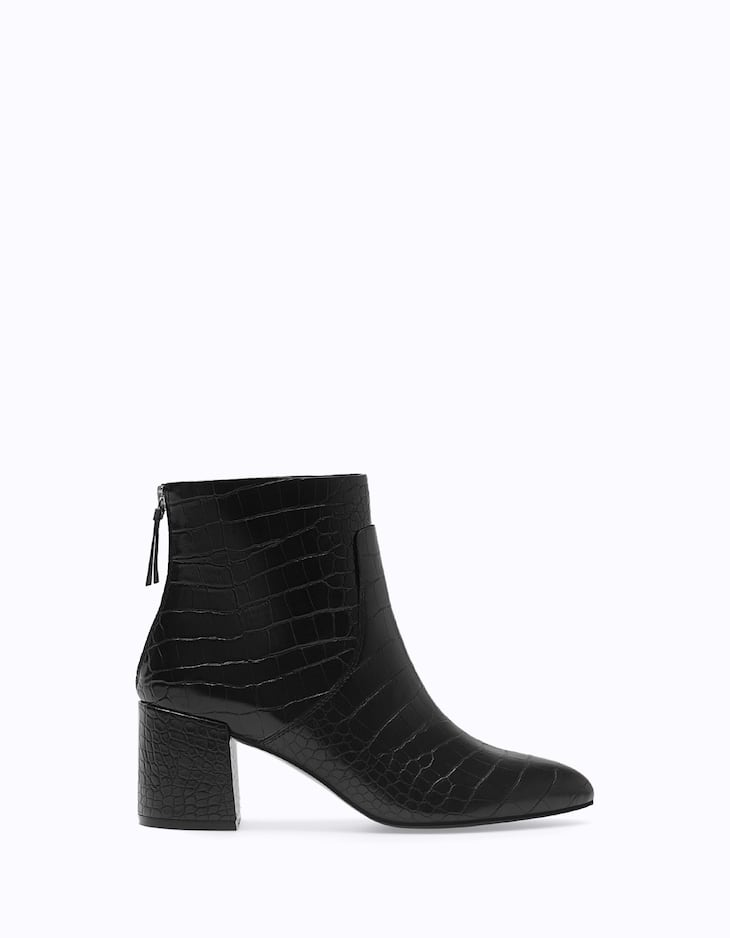 Ankle boots with embossed heels