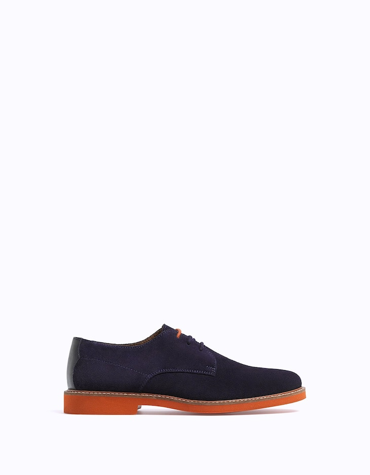LEATHER brogues with colour sole