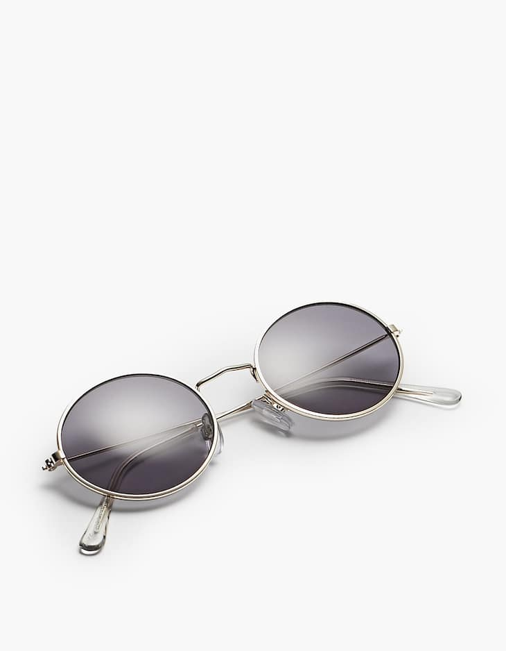 Small oval sunglasses with metal frame
