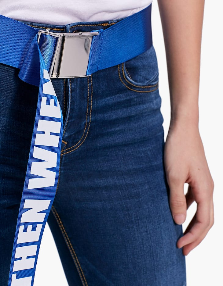 Belt with clip buckle and 'If not now then when' slogan