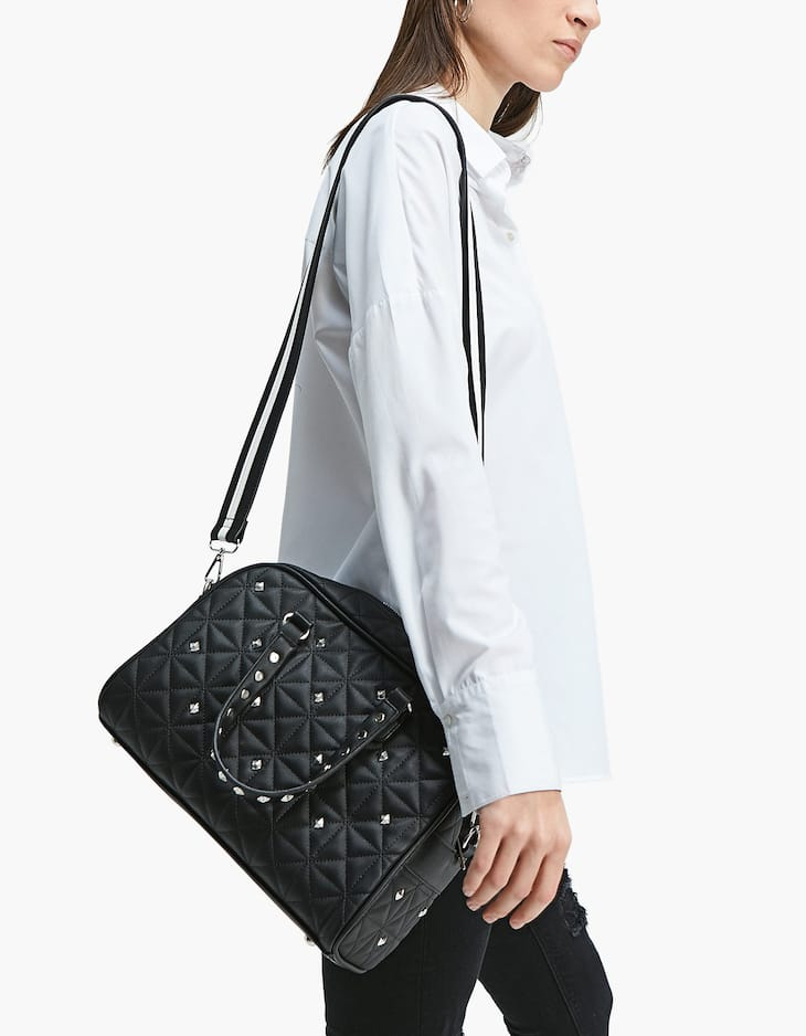 Quilted bowling bag with studs