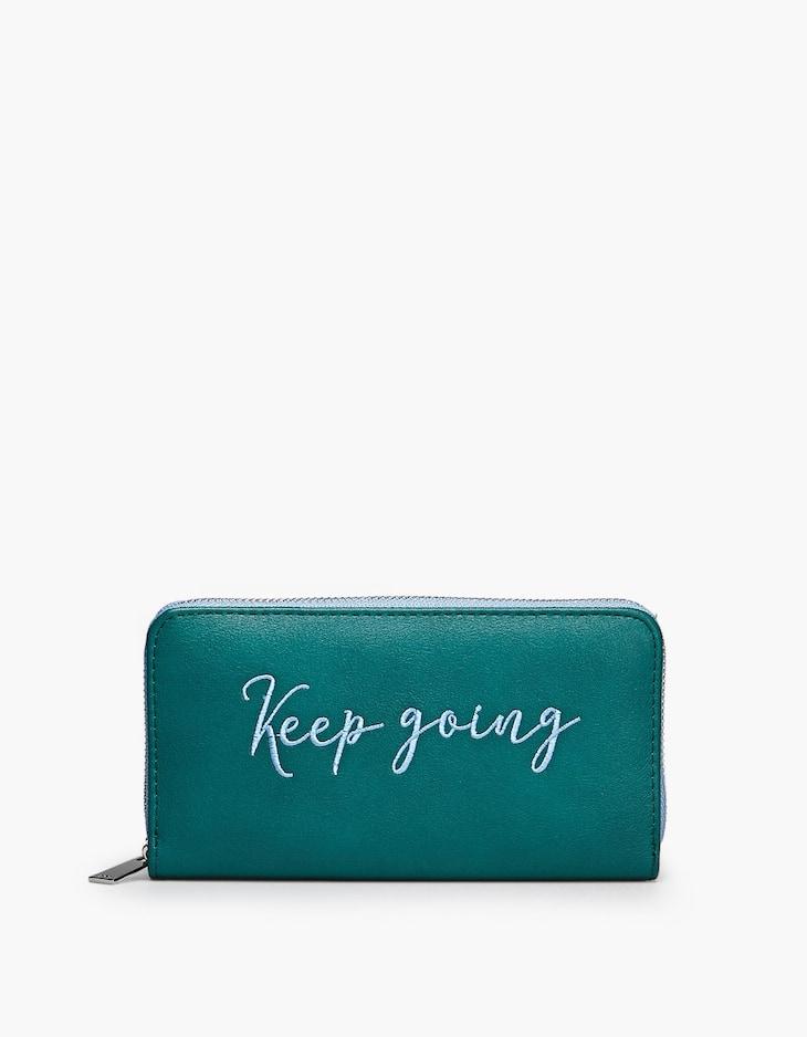 Zip purse with slogan