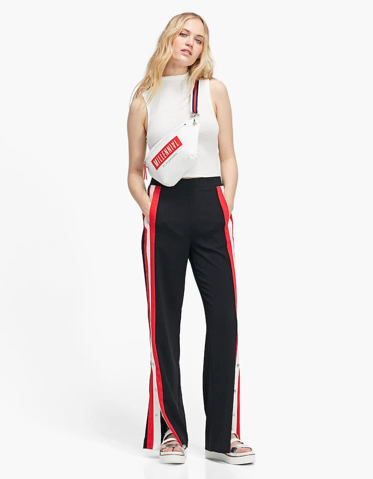 Sports trousers with snap buttons