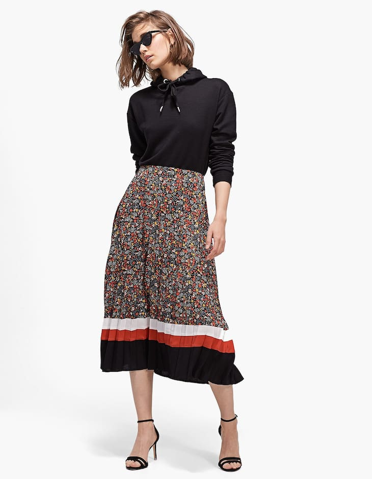 Pleated skirt with a striped and floral print