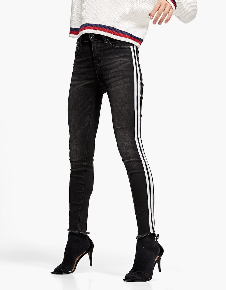 Skinny trousers with side stripes