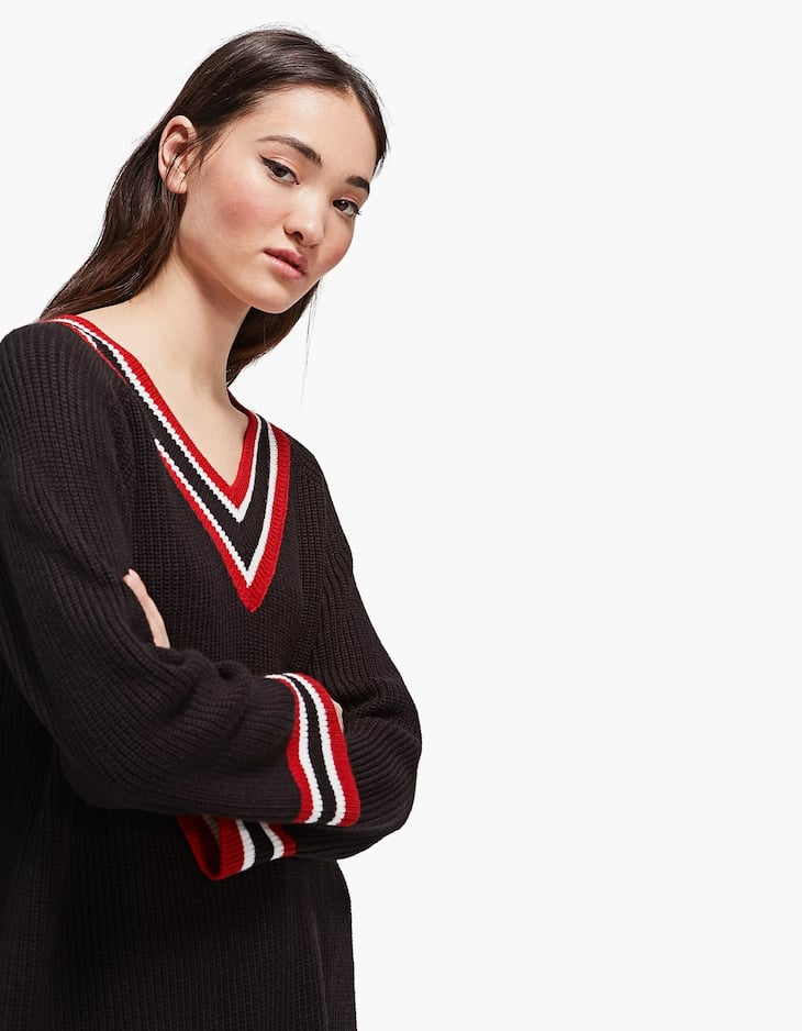 Oversized sweater with striped neckline
