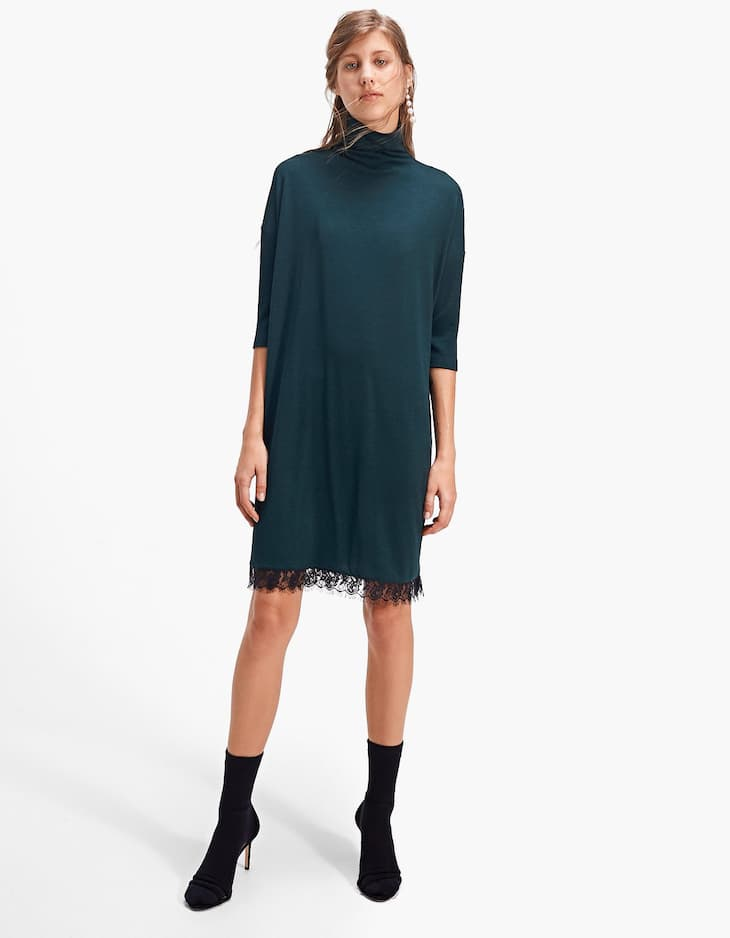 Polo neck dress with lace trim along the hem