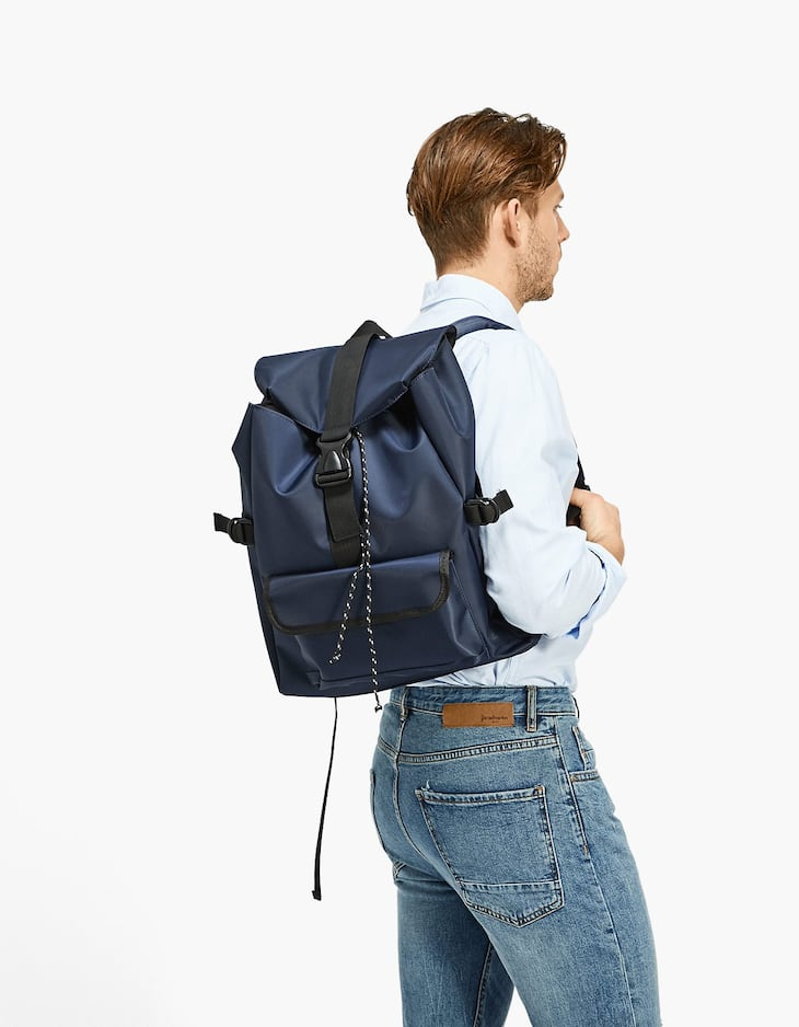 Navy blue nylon backpack with flap