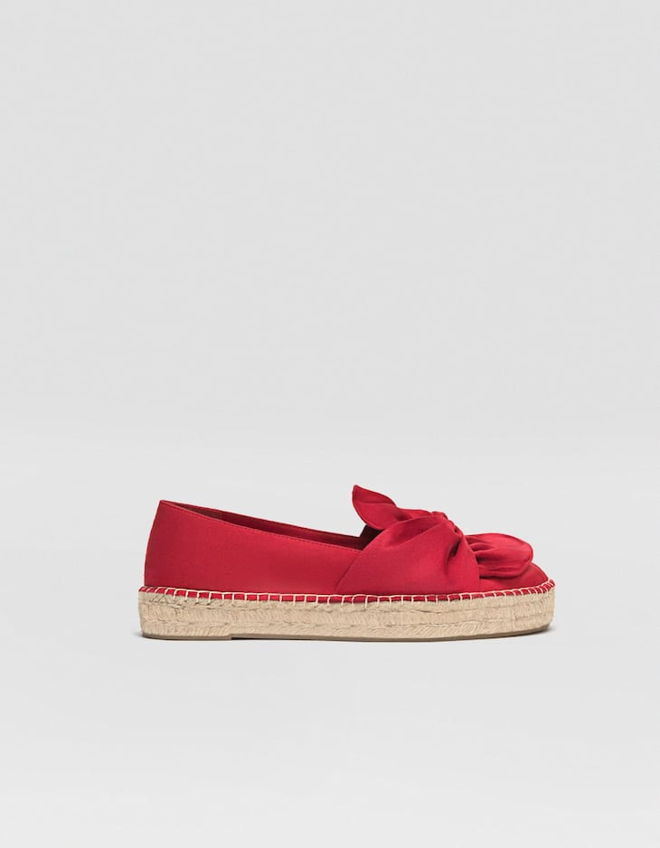 Red espadrilles with bows