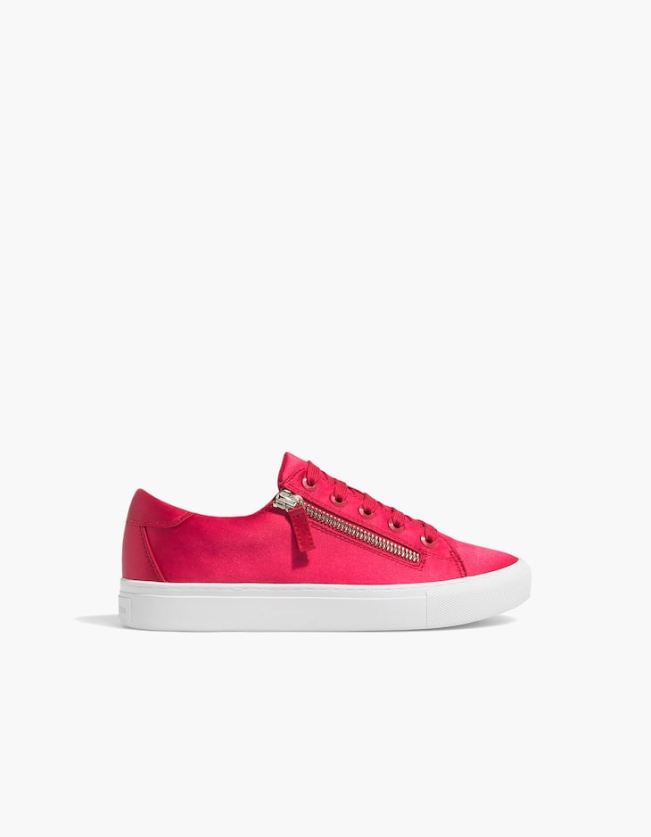 Red plimsolls with zips